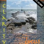 vision board collage ~ stone promontory out to sea with wording clarity and focus